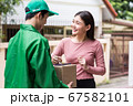 courier deliver package, woman client sign 67582101