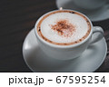 Coffee in white cup on table at coffee shop 67595254