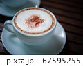 Coffee in white cup on table at coffee shop 67595255