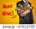 Businessman holding cardboard box filled with retro radio sets and 'More news' sign on yellow background. 67613785