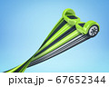 3d rendering of green hoverboard with trail on blue background 67652344