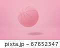 3d close-up rendering of light pink basketball bouncing on light pink background. 67652347
