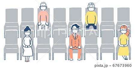 一定の距離をとって座席に座る人々 67673960