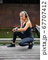 Beautiful fitness woman runner using smart watch phone 67707412