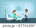 Doctor with surgery patient 67741097