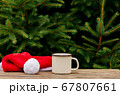 cup of coffee and Christmas hat on wooden table 67807661