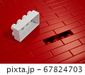 Wall from plastic red building blocks 67824703