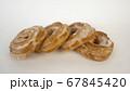 A lot of custard cake donuts close up. 67845420