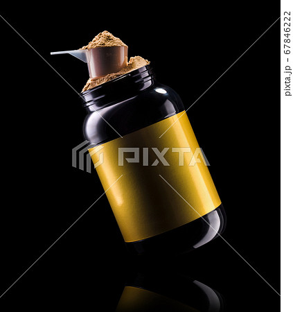 A scoop of chocolate protein powder drink in black plastic container isolated 67846222