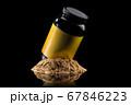 Plastic jar of sport nutrition like whey protein casein, bcaa on heap of powder 67846223