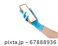 Doctor's hand in medical gloves holding phone isolated on white 67888936