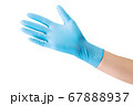 Doctor's hand in medical gloves showing palm isolated on white 67888937