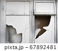 Old broken white window 67892481
