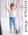 Adorable little girl walk through the windowsill in studio 67918228