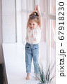 Adorable little girl walk through the windowsill in studio 67918230
