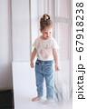 Adorable little girl walk through the windowsill in studio 67918238