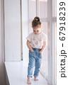 Adorable little girl walk through the windowsill in studio 67918239