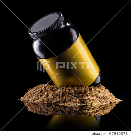 Plastic jar of sport nutrition like whey protein casein, bcaa on heap of powder 67919078