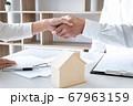 Real estate agent and customers shaking hands 67963159