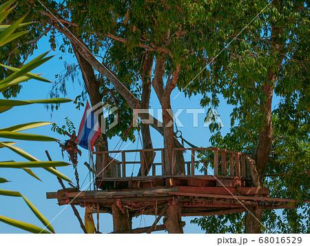 A tree house with Thai flag 68016529