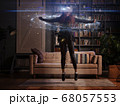 Woman is using virtual reality headset. Elements of this image furnished by NASA. 68057553