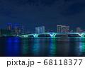 晴海から豊洲のビル群とライトアップされた豊洲大橋 68118377