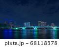晴海から豊洲のビル群とライトアップされた豊洲大橋 68118378