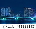 晴海のビル群と東京スカイツリー、ライトアップされた豊洲大橋 68118383
