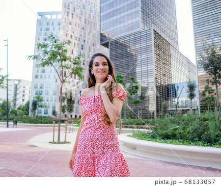 woman in sexy stylish dress posing in the modern city with skyscrapers on background 68133057
