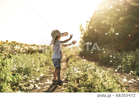 Happy kid in the countryside enjoying life and nature. 68203472