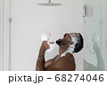 Angry soapy African American man dissatisfied by broken shower 68274046
