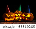 Halloween pumpkin head jack lantern on dark wooden background 68519285