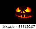Ghastly Halloween pumpkin head jack lantern on black background 68519287