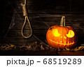 Halloween pumpkin head jack on wooden background 68519289