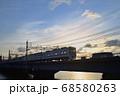 夕暮れの中川橋梁を渡る京成電車 68580263