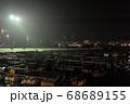 山口県下関市唐戸市場の横にあるライトアップされた大きな生簀と関門の夜景 68689155