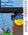 下関市はいからっと横丁入口から見るライトアップされた遊園地の様子 68689156