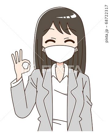 マスクを付けてOKのハンドサインをしているスーツの女性の上半身 68722317