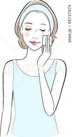 メイクオフシートで化粧を落とす女性 68737974
