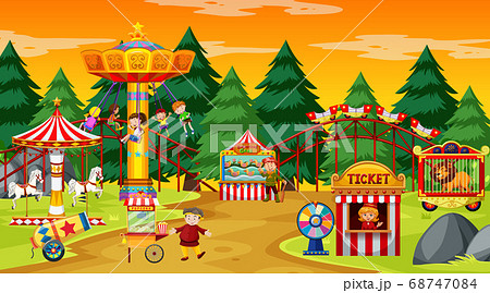 Amusement park scene at daytime with yellow sky 68747084
