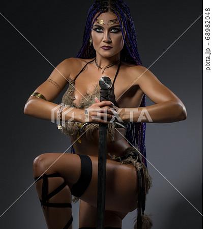 Beautiful horsewoman in nice bicini with a sword 68982048