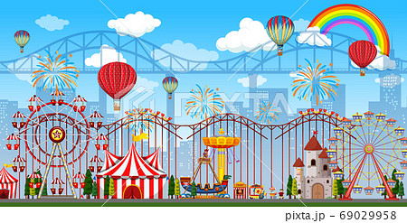 Amusement park scene at daytime with rainbow and 69029958