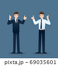 Smiling businessman standing and thumb up to cheerful for his successful career. 69035601