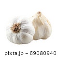 Close-Up Of Garlic Bulbs Against White Background 69080940