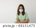Woman in medical mask hands crossed 69151473