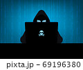 Silhouette of hacker wearing hood using laptop computer with glow in the dark blue skull and crossbones logo in dark room on blue binary code number background 69196380