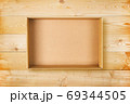 Open cardboard box on wooden background. Empty cardboard package on natural wooden texture 69344505