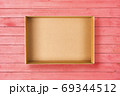 Open cardboard box on pink background. Empty cardboard package on pink wooden texture 69344512