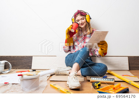 Happy girl in protective headphones and gloves 69564170