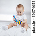 Photo of a ten-month-old choosing baby between rattle and ball 69674953